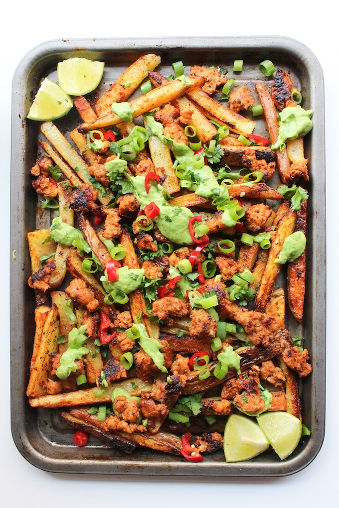 Baked Cajun Fries with Chorizo Sausage and Avocado Crema